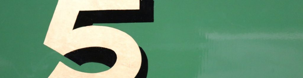 The number five on green background